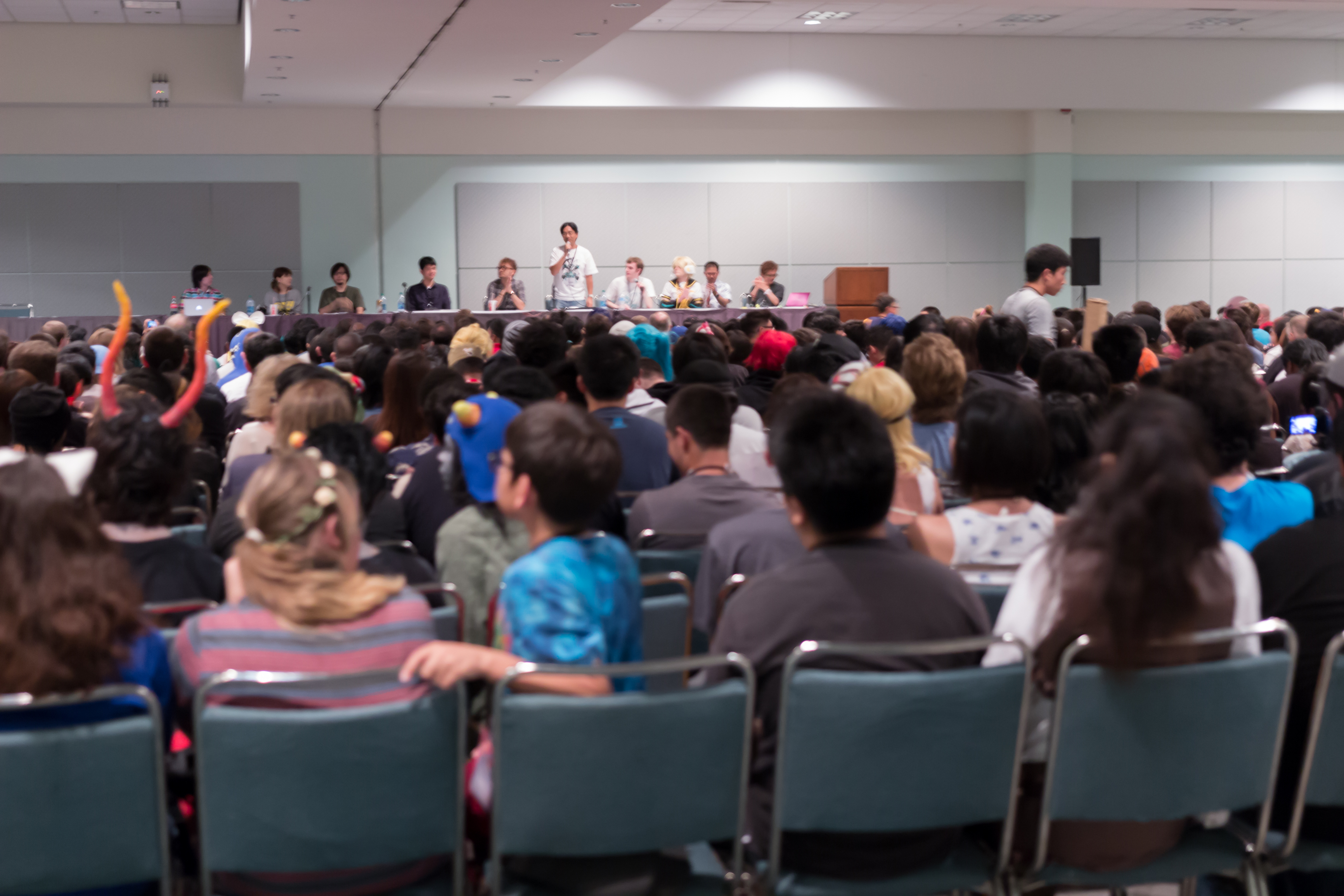 Photo of a panel at an anime convention.
